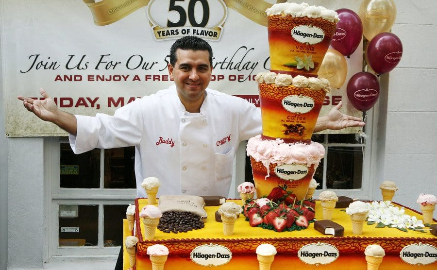 Buddy standing in front of the Haagen Dazs cake