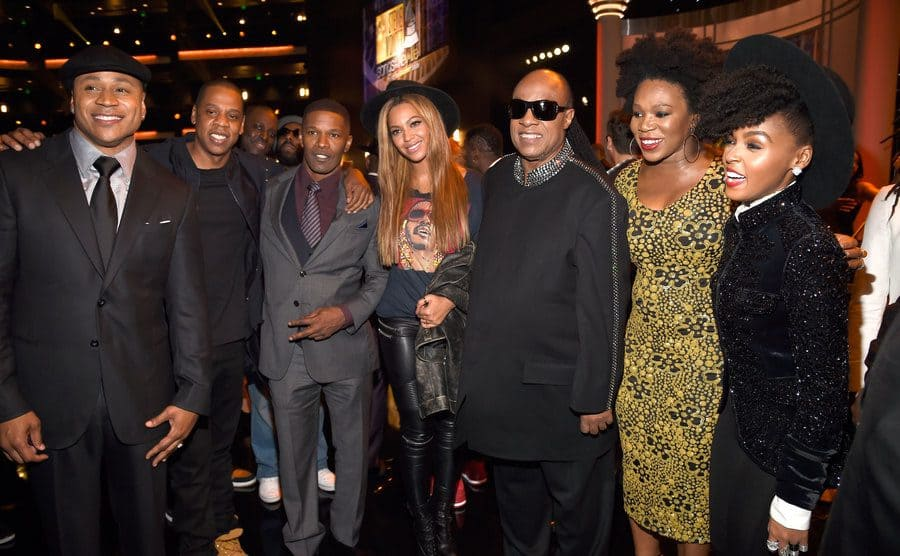 LL Cool J, Jay Z, Jamie Foxx, Beyonce, Stevie Wonder, Aisha Morris, and Janelle Monae posing at an event