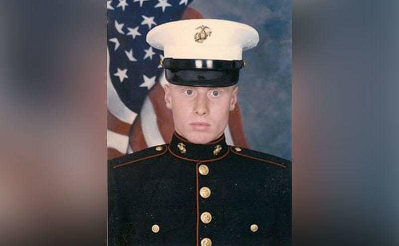 David Cox's military service photo in full uniform and cap.