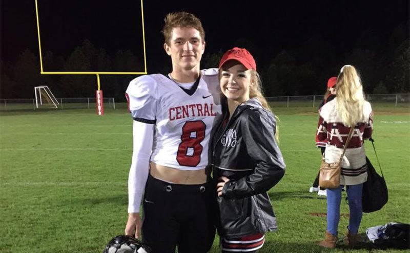 Emma Walker and Riley Gaul pose for a picture of the football field.