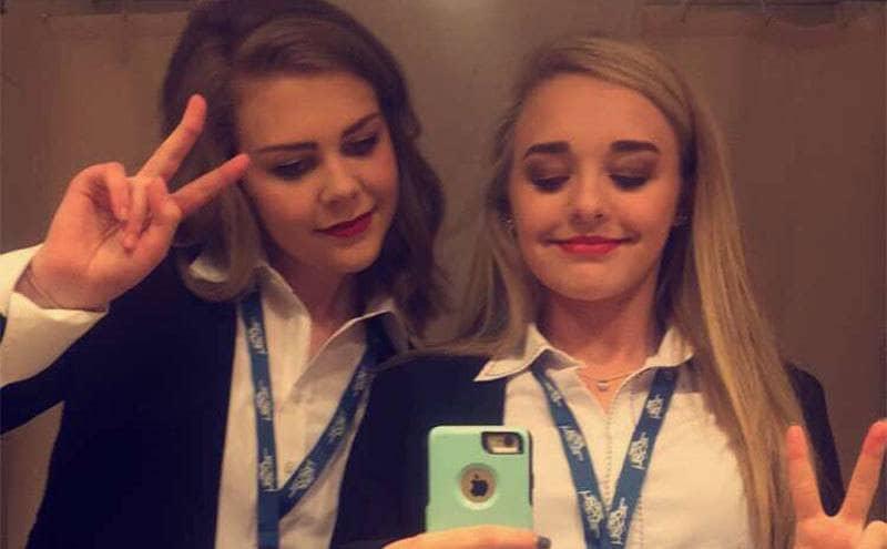 Keegan Lyle and Emma Walker take a bathroom mirror selfie.