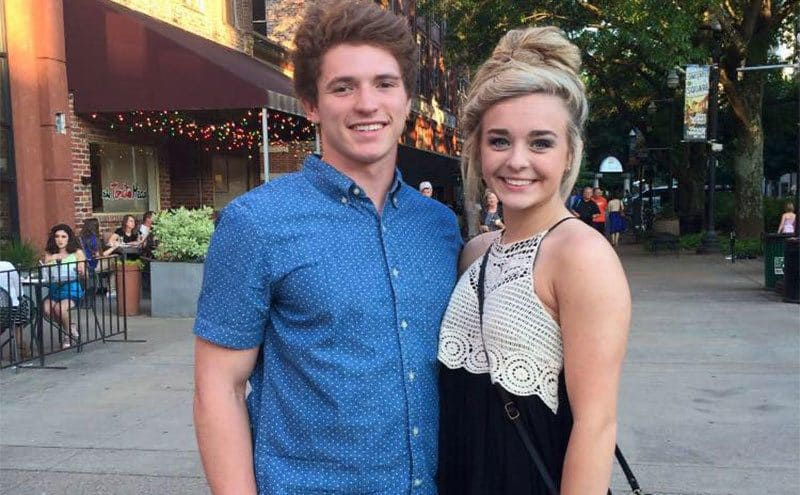 Emma Walker is posing for a picture with Riley Gaul while out on a date.