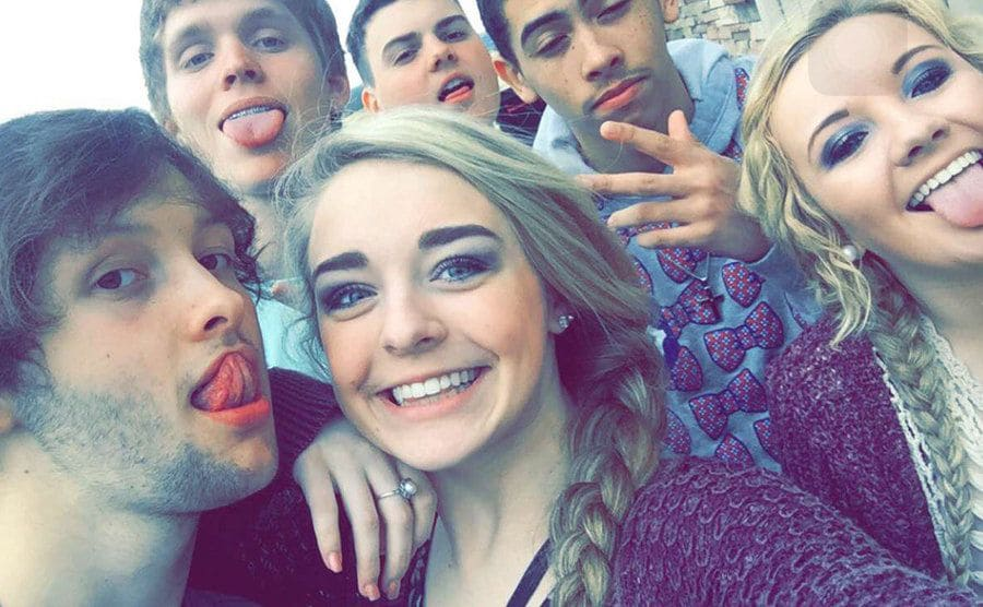 Emma and a bunch of friends take a selfie.