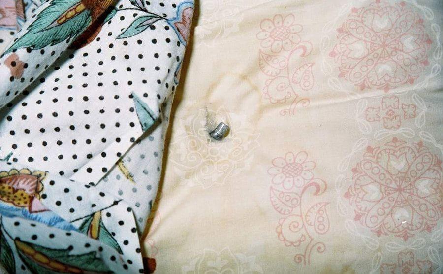 A bullet found inside a pillow.