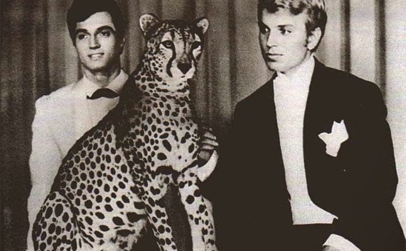 Siegfried and Roy performing with a cheetah on a cruise ship.