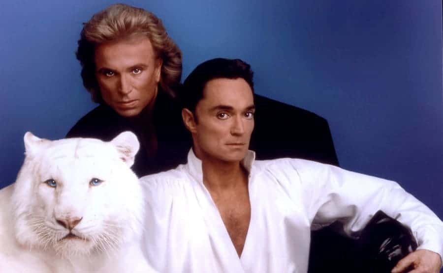 Siegfried and Roy pose with a white tiger.