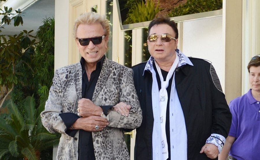 Siegfried helps to escort Roy to an event.