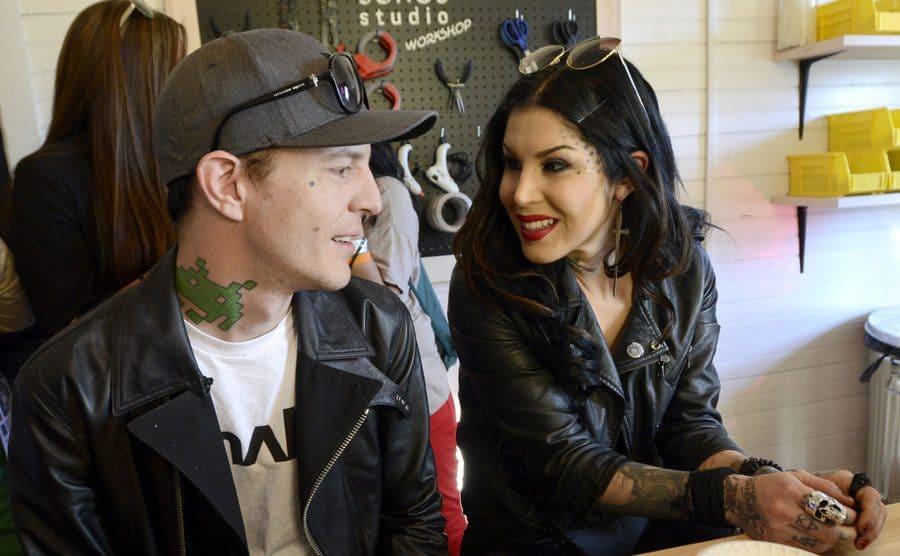 Kat Von D and Deadmau5 sitting at an art studio together