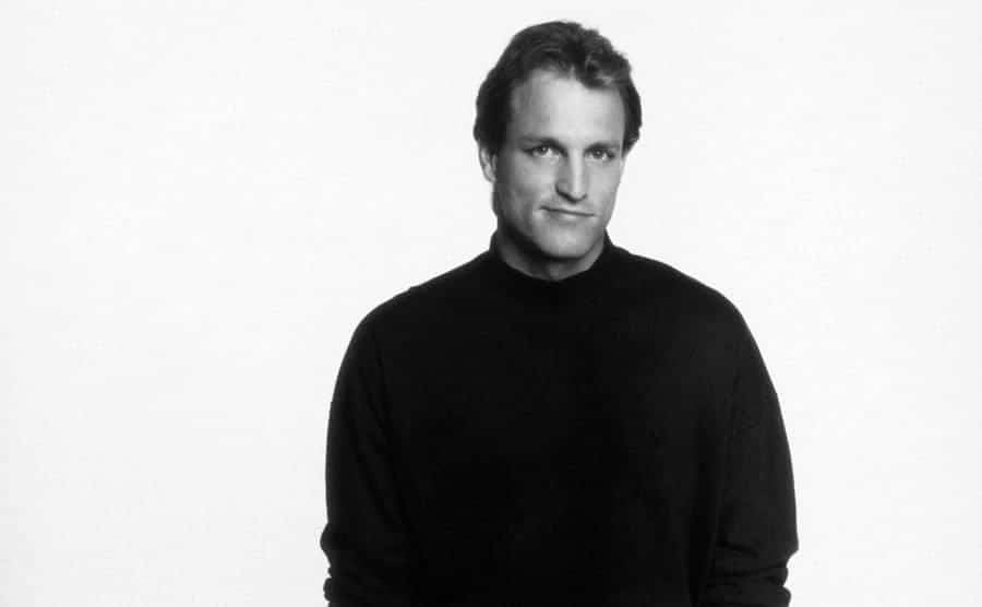 Woody Harrelson posed for a photo with his hands in his pockets.