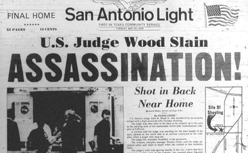 Newspaper headline about the assassination.