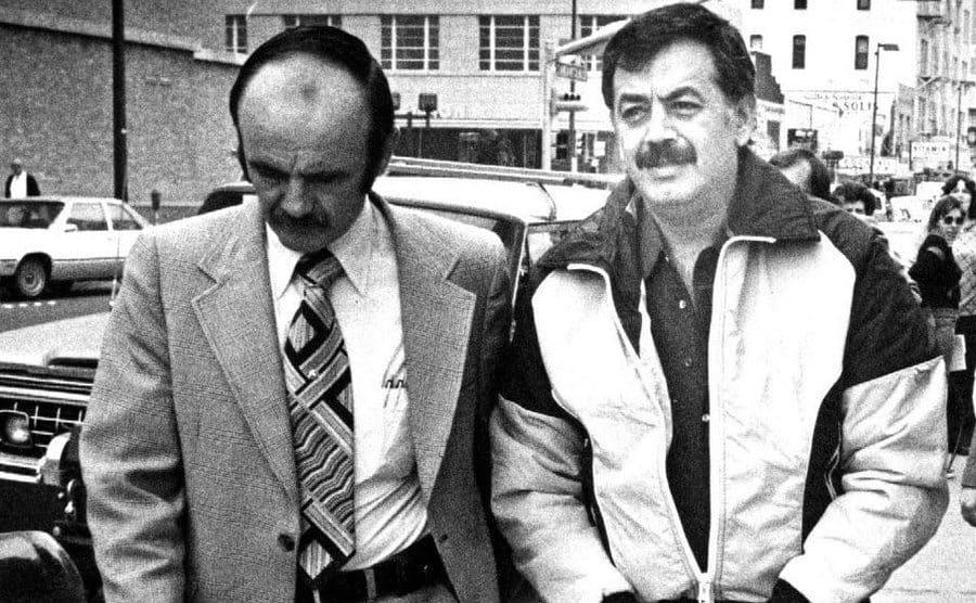 "Jamiel ""Jimmy"" Chagra being escorted to court in handcuffs."