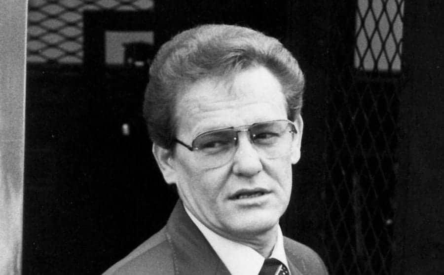 A photo of Charles Harrelson in a suit and tie.