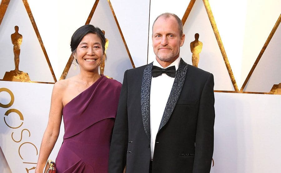 Laura Louie, Woody Harrelson arrives at the 90th Annual Academy Awards