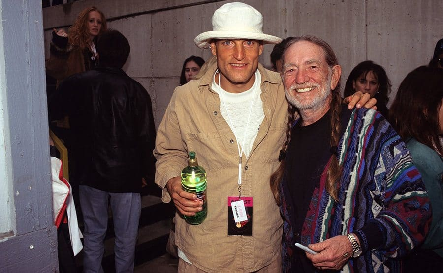 Woody Harrelson and Willie Nelson backstage at Farm Aid.