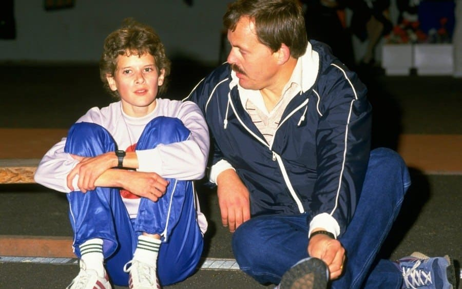 Zola Budd of Great Britain chats to her coach at Crystal Palace in London