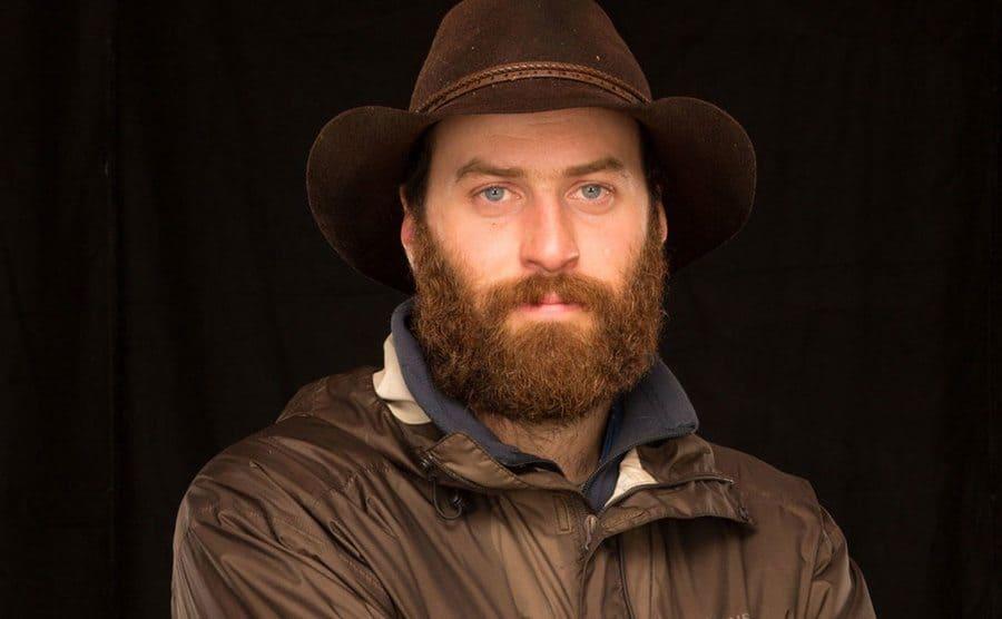 Portrait of Matt wearing a brown hat.