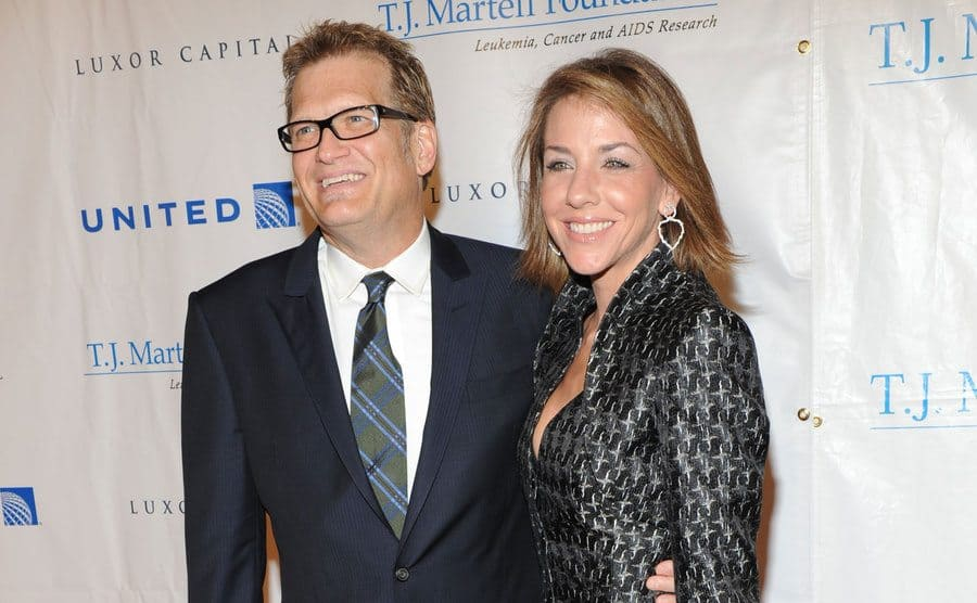 Drew Carey and his wife Nicole Jaracz are attending an event together.