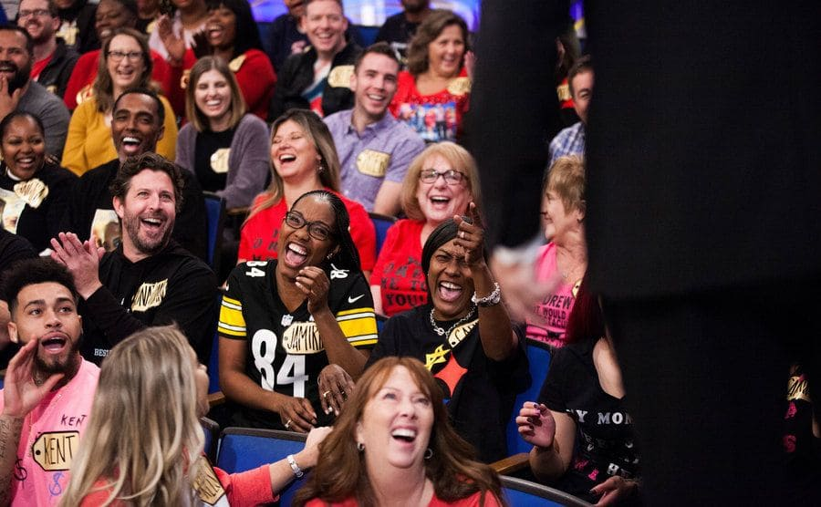 Audience members are laughing while Drew Carey asks questions during a taping of The Price is Right at CBS Television.