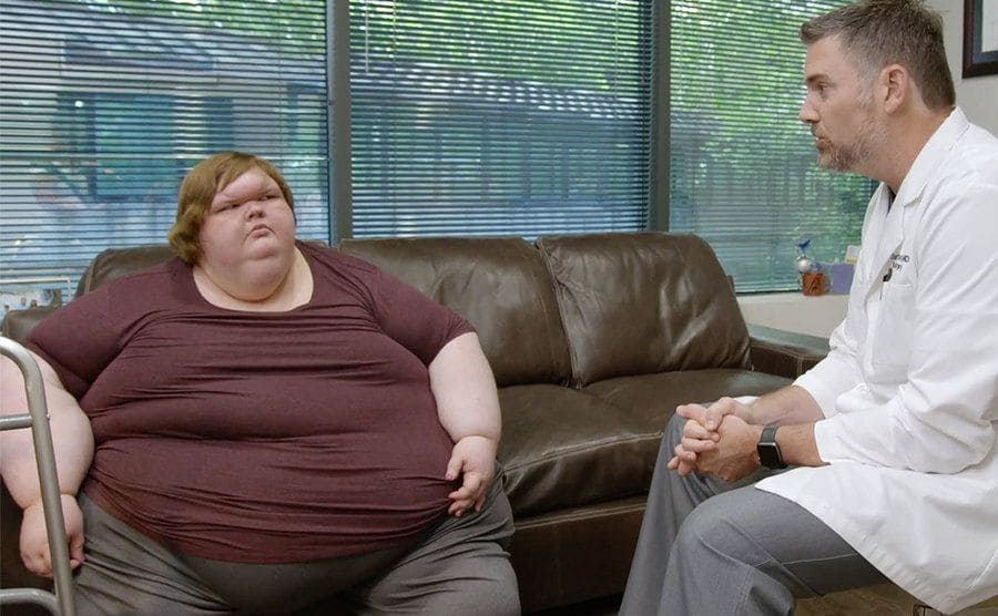 Tammy sits down with her doctor at his office.