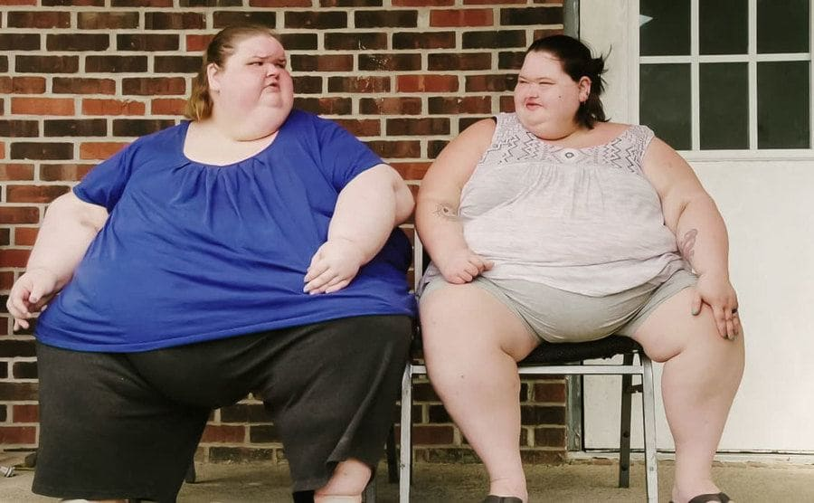 Amy and Tammy are sitting on their front porch.