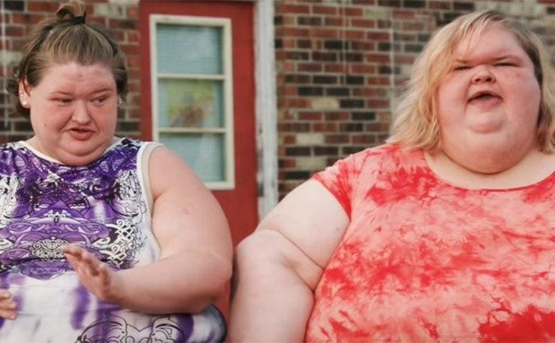 Tammy and Amy sit on their front porch.