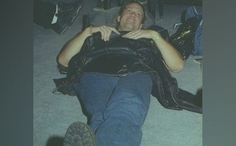 A young Jesse James is lying down in his garage.