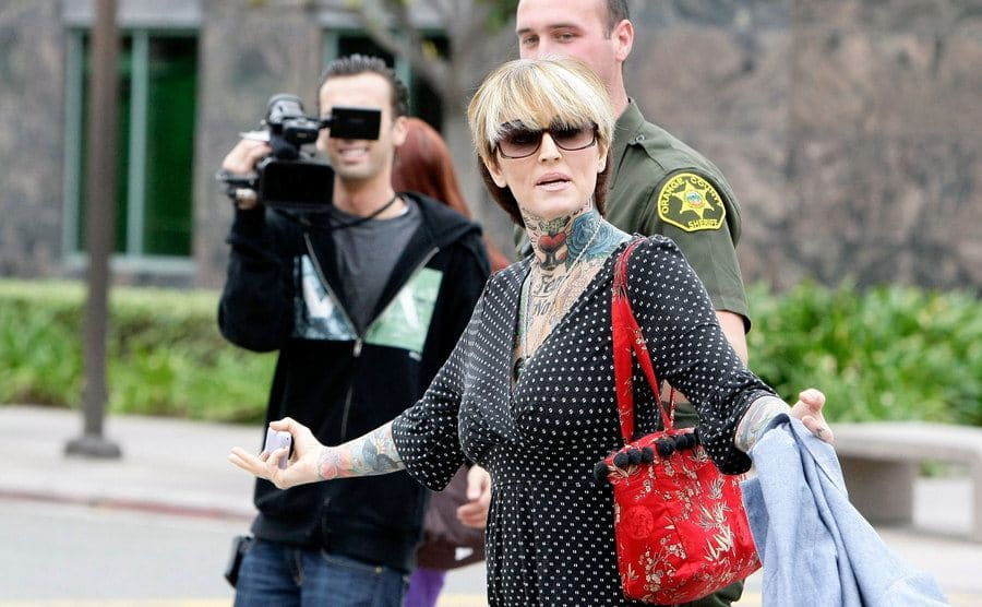 Janine Lindemulder is escorted into a Justice Center by Orange County Sheriff Deputies.