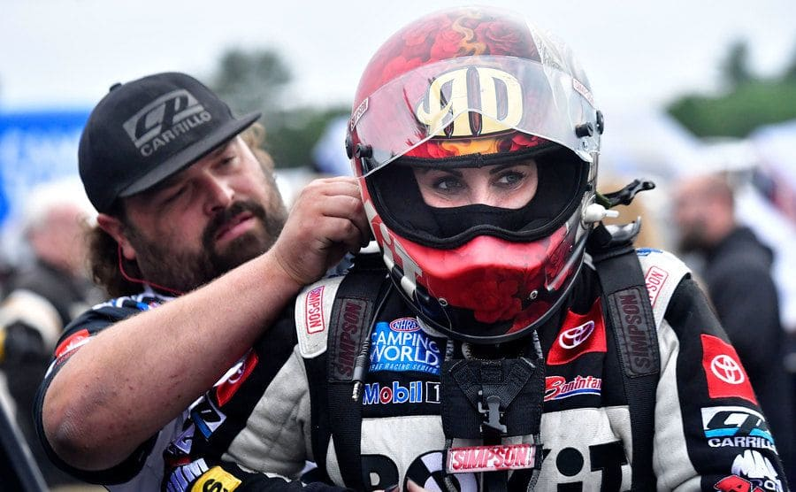 Alexis DeJoria prepares for the opening round during the NHRA Nationals.