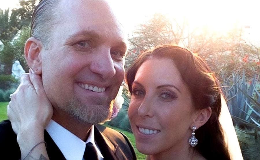 Jesse James and DeJoria smile at the camera after tiding the knot.