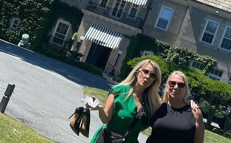 Kylie McCollough and DeJoria's mother pose for a photo outside their house.