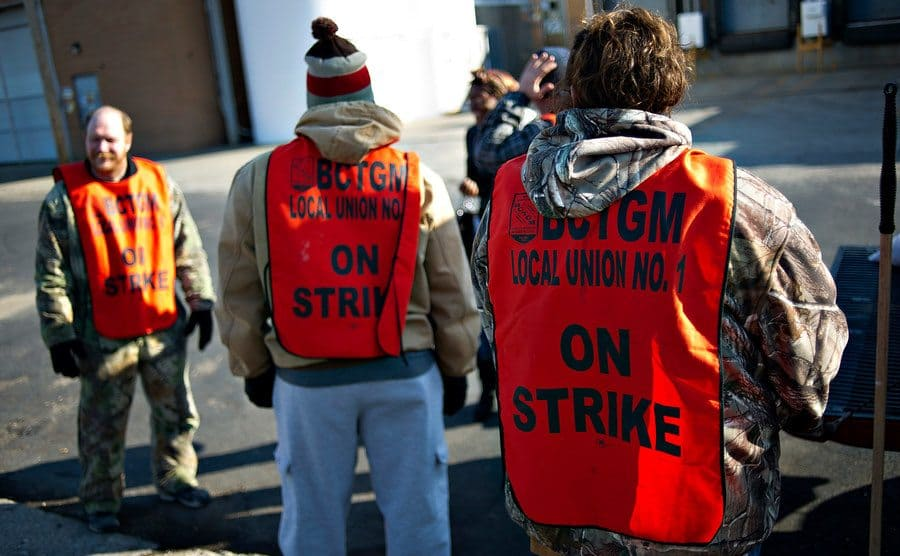 Striking workers picket outside a Hostess Brands Inc. bakery.
