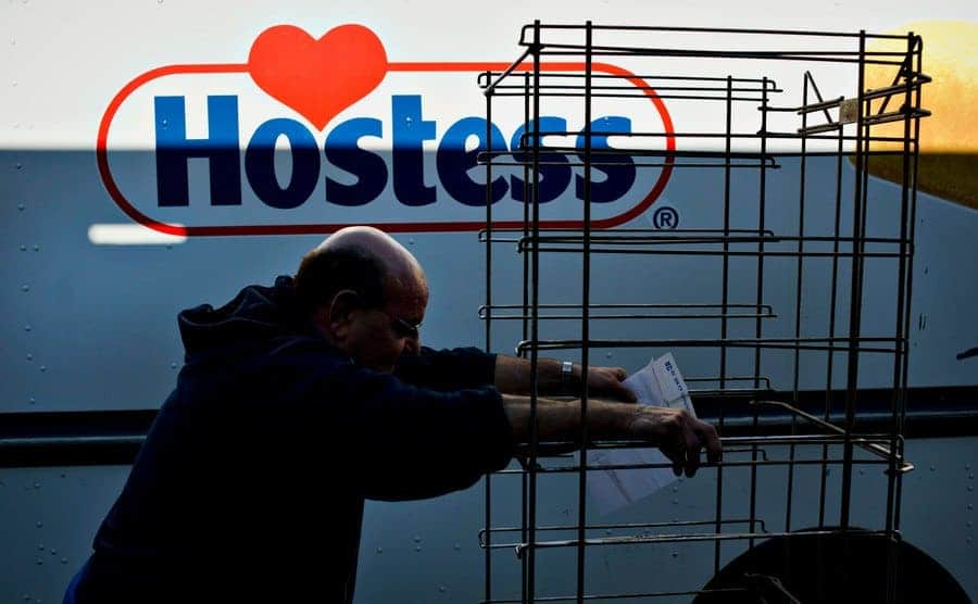 A Hostess driver for 16-years, pushes an empty rack alongside his truck.