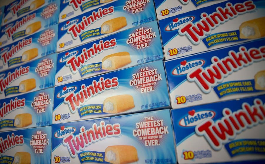 Boxes of Hostess Twinkies snack cakes are stacked.