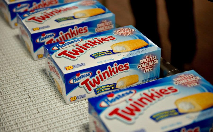 Boxes of Hostess Twinkies snack cakes travel on a conveyor.