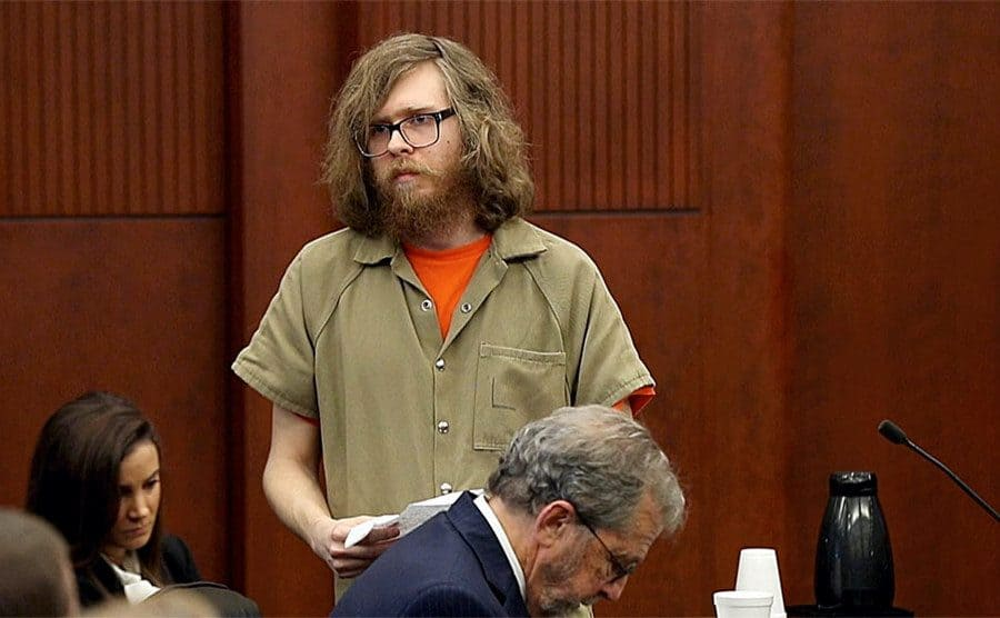 Matthew Phelps stands in court.