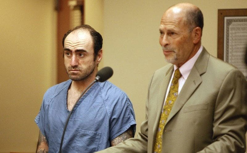 James McVay and his lawyer stand in court.