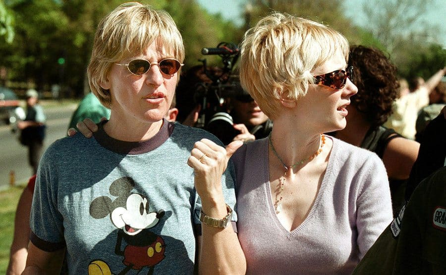 Ellen Degeneres and Anne Heche are surrounded by a crowd.