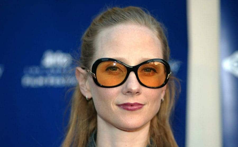 Anne Heche wears sunglasses during a Premiere.