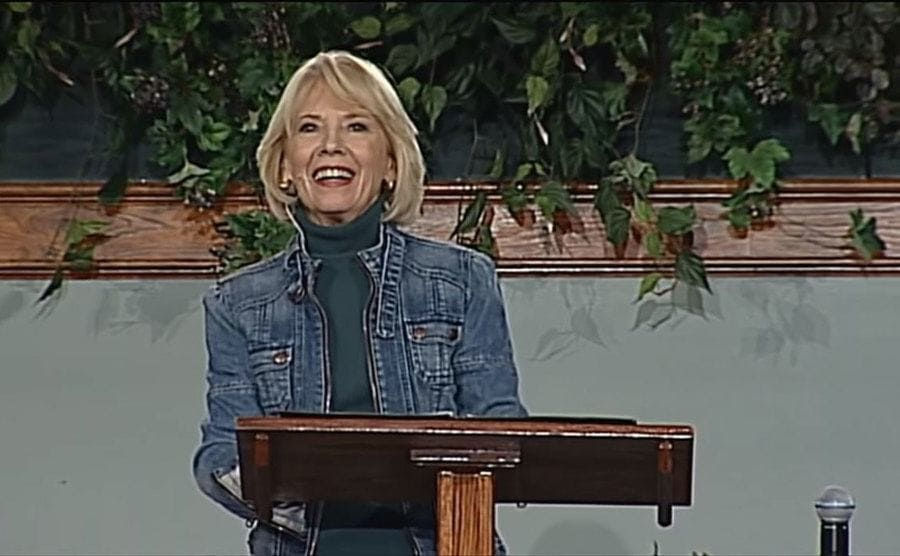 Nancy Heche is speaking about her book before a congregation.