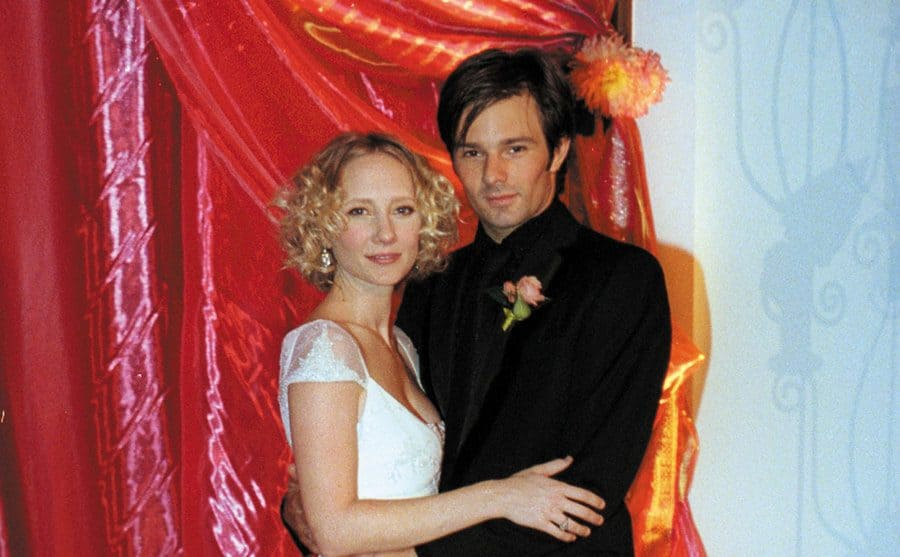 Anne Heche poses with her husband Coley Laffoon on their wedding day.