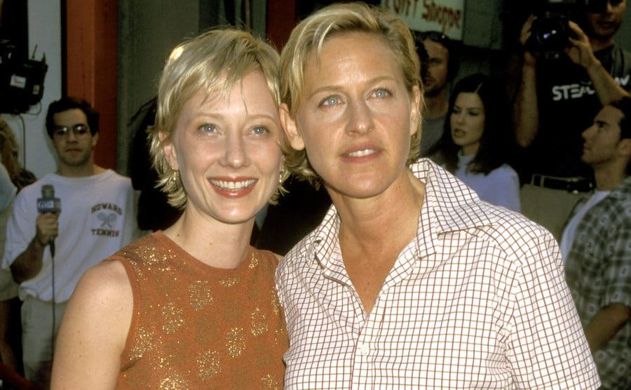 Anne Heche and Ellen DeGeneres pose for the press.
