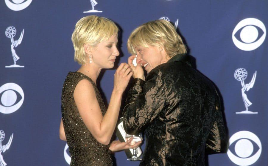 Anne Heche wipes Ellen DeGeneres's tears away.