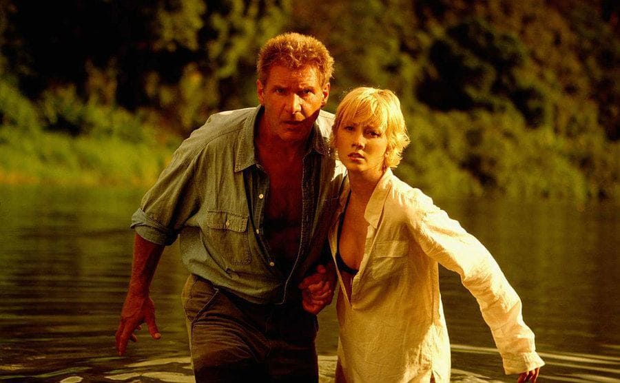 Harrison Ford and Anne Heche cross a river in a still from 'Six Days, Seven Nights'.