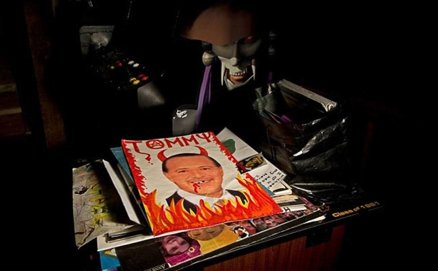 The Devil shrine on top of a desk in the dark.