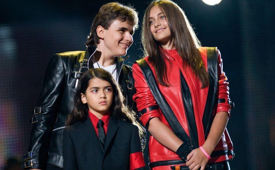 Prince Michael Jackson, Blanket Jackson, and Paris Jackson appear on stage.