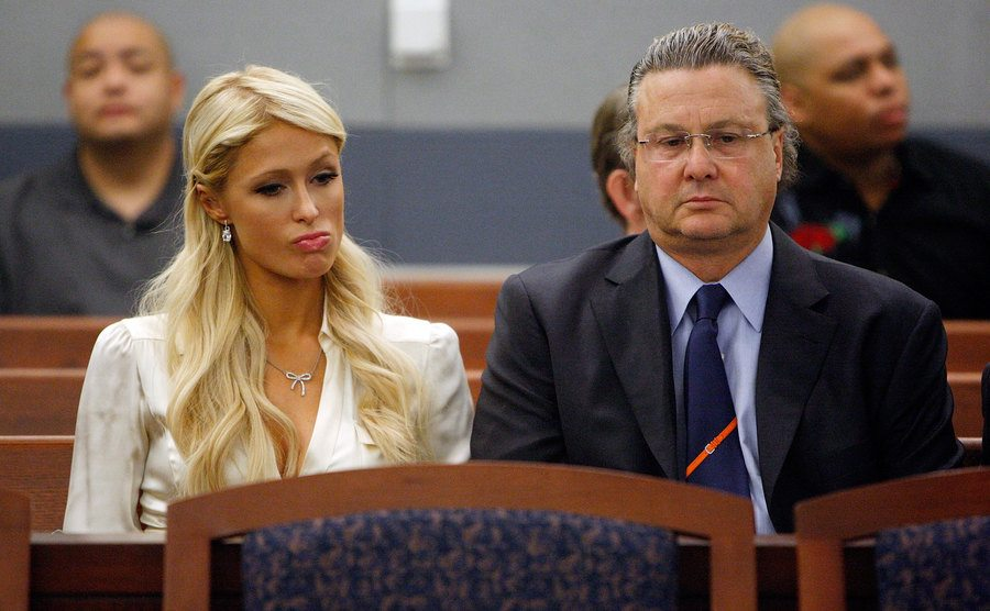 Paris Hilton and her attorney David Chesnoff sit in court.