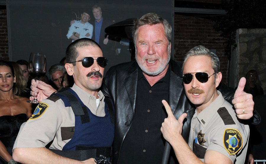 John Langley poses with actors dressed as local sheriffs.