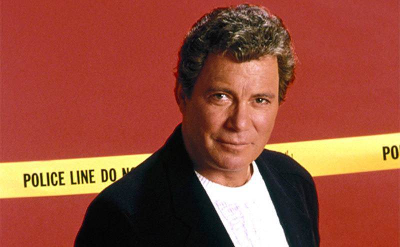 Shatner poses in front of police tape.