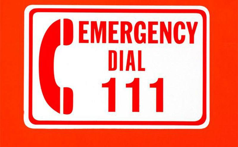 """An"""" Emergency Dial 111"""" sign."""