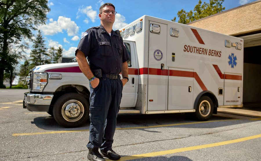 An Actual EMT, stands beside his rig with pride.